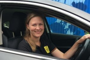 KUC staff member in car