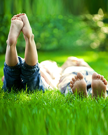 kids lying on grass