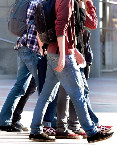 young people walking with backpacks